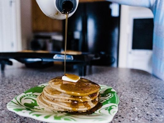 Oatmeal pancake stack with syrup drizzle