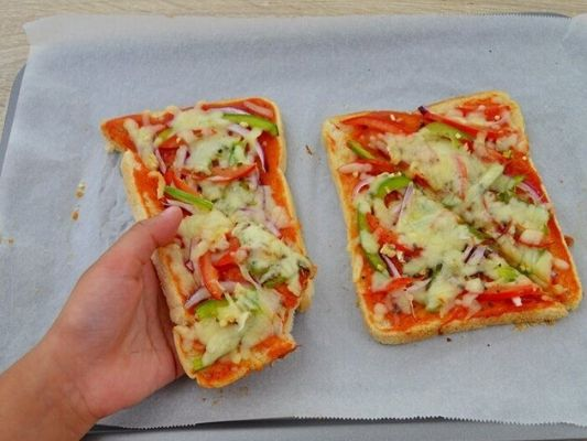 Bread pizzas are a great way to get kids in the kitchen