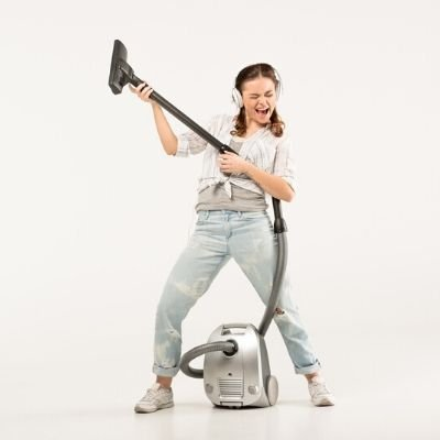 Busy mom dancing with a vacuum cleaner