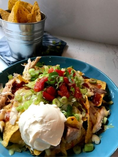 Quick nachos recipe with chicken and healthy salad on top