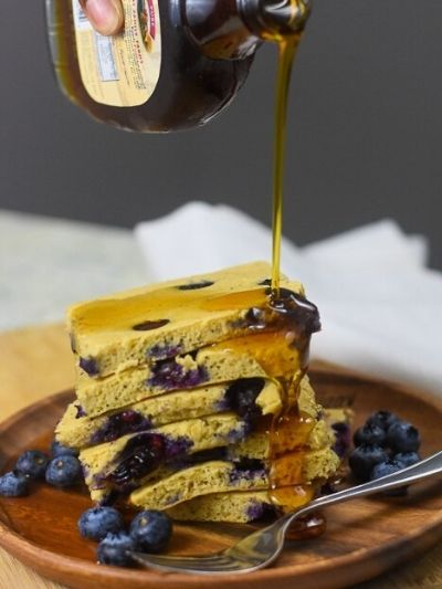 Stack of blueberry pancakes made in a sheet pan