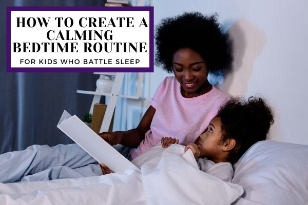 Mom and daughter reading book at bedtime