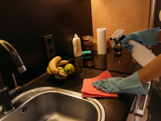 Nighttime dish washing is an essential part of an evening cleaning routine.